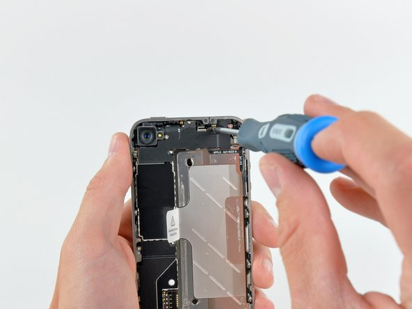 Image 1/3: No EMI shield will stand between us and the innards of this iPhone 4!