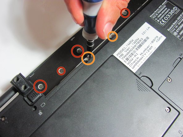 Remove the battery, then unscrew the 7 3 mm Phillips screws behind the battery. Make sure they go in separate, organized piles.