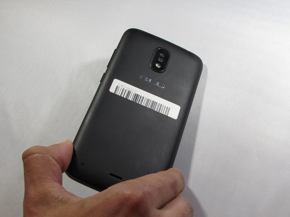 To remove the back cover, locate the safety indented notch on the bottom left corner as the screen is facing down.