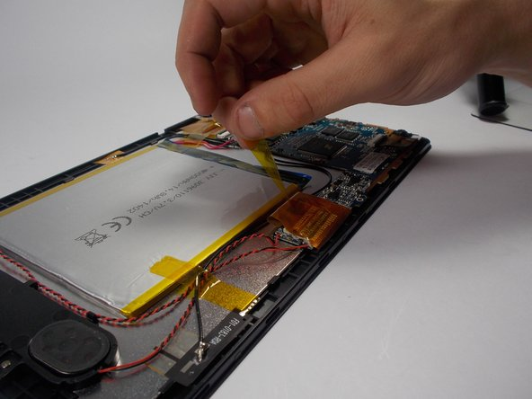 Carefully remove the tape that is holding down the battery.