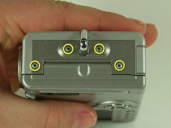 Remove the four screws on the left side of the camera.