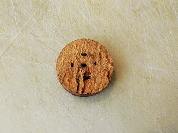 Image 1/2: Your cork slice should now have four marks equidistant from the center mark.