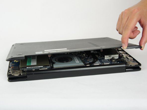 Try to use the opening tool at multiple points. Lifting the back casing abruptly could damage the laptop.