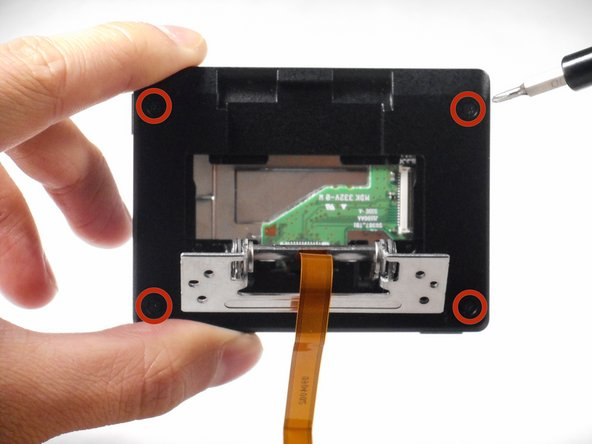 Image 1/2: Using your fingers, remove the two plastic borders that case the LCD screen.