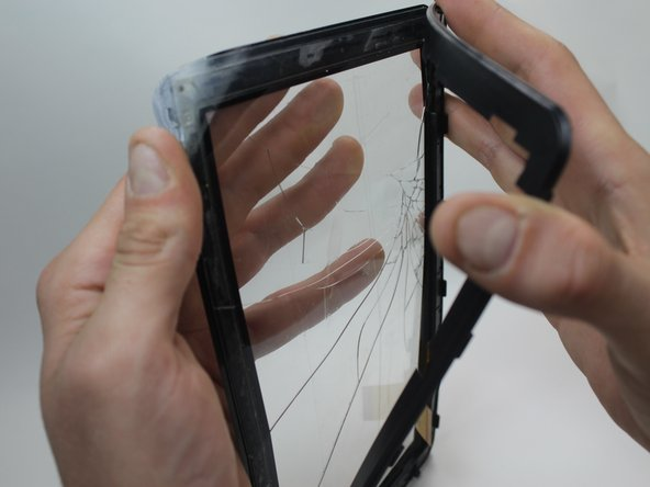 Pull the thin plastic screen casing apart and you can remove the damaged screen.