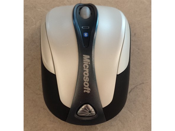 Pop off the lazer symbol from the back of the mouse. it is stuck on with a simple adhesive.