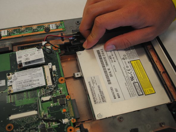 Continue to slide the optical drive until it can be removed from the computer.