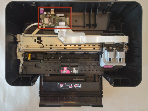The mother board is located at the back of the printer.