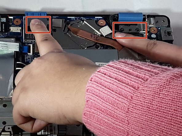 Located at the top are two silver plates that connect to the laptop screen. These are your hinges.