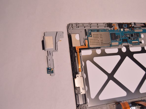 Remove the Phillips #00 screws from the plastic part holding down the motherboard.
