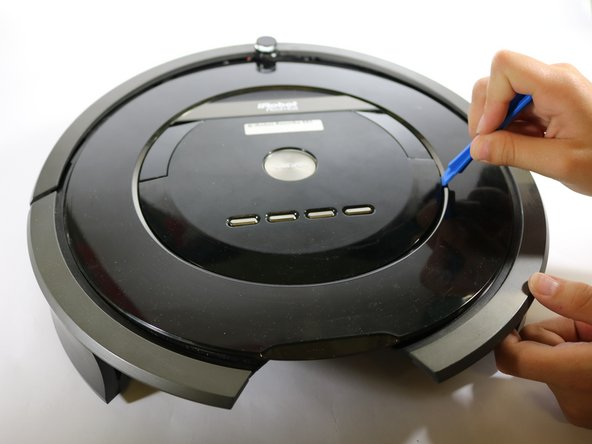 Flip your Roomba over so you are looking at the face of your device.