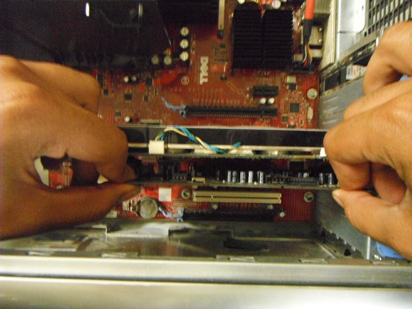 Gently grasp the sound card and remove it from the motherboard. Pull directly outward and apply extra force if necessary.