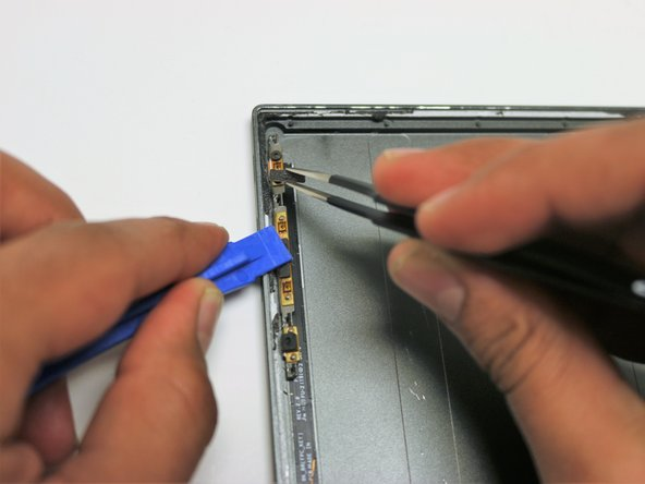 Image 1/1: With tweezers, pull out the power button.