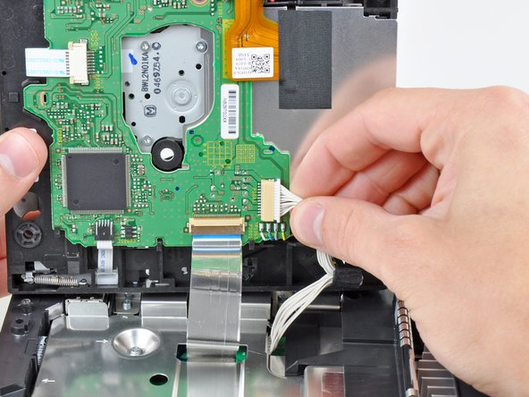 Pull the DVD drive power cable away from its socket on the DVD drive.
