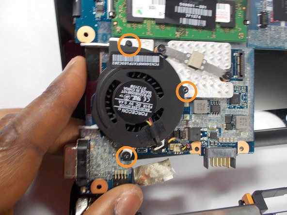 Image 2/2: Remove the screws that hold in the fan.