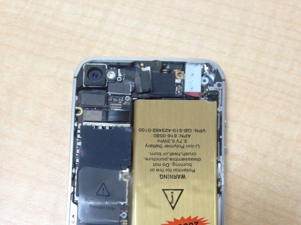 The Iphone will open up and you will see a metal panel by the camera on the top left side of the phone as well as a smaller metal panel on the  bottom left side of the phone. These are required to be removed before taking out the battery. A Phillips #000 screwdriver will work best for removing them.