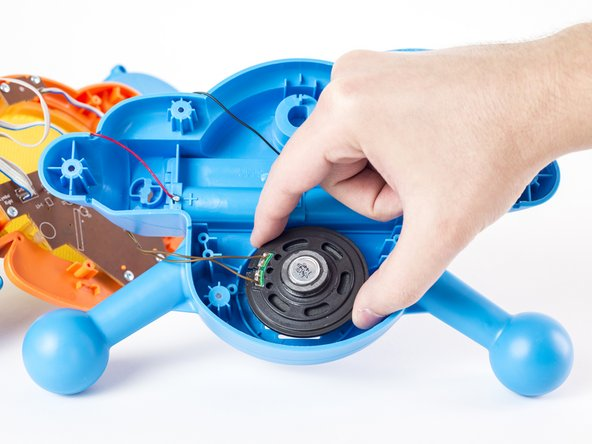Using your hand, gently remove speaker from its housing.