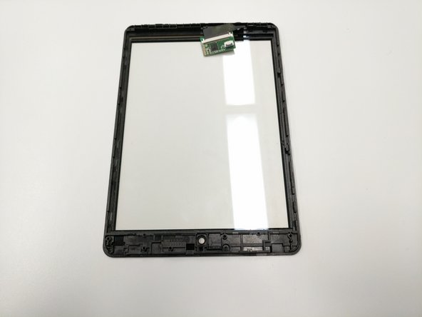 Upon separating the tablet's components from the screen's frame, the screen should now be isolated.