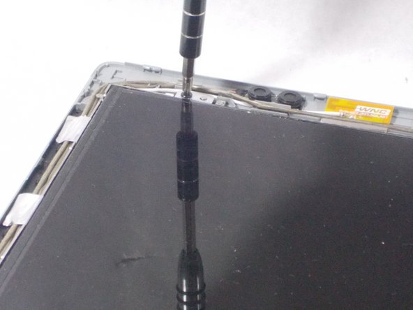 Once the plastic cover is off locate the 4 screws in the corners of the screen and unscrew them