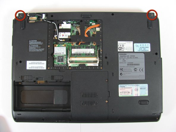 Remove the final two screws on the bottom side of the laptop holding the LCD display in place.