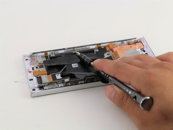 Remove the five 4mm T5 screws connecting the SD card side panel to the device.