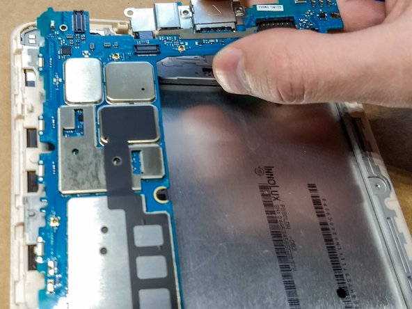 Remove the motherboard by pulling it straight up and away from the tablet body.