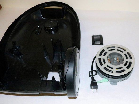 Remove the cord reel and cord from the vacuum body.