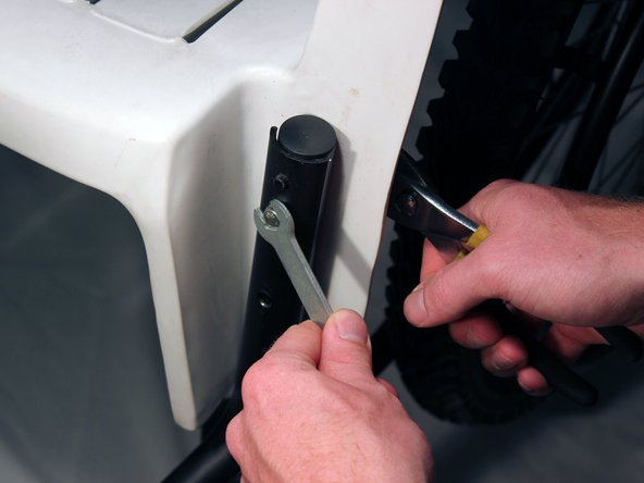 Locate the screws that hold the back frame, chair, castor wheel, and front frame together.
