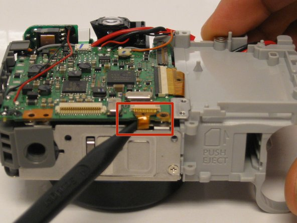 Use the spudger to carefully remove the attached ribbon cable.