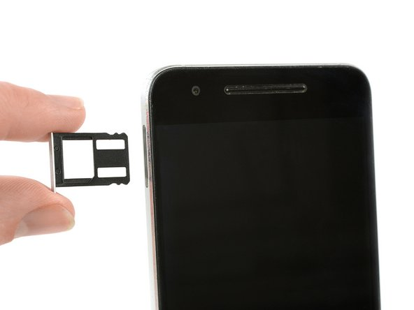 Use a SIM card eject tool, to pop out and remove the SIM card tray.