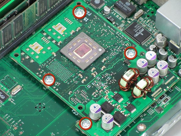 Remove the four screws holding the CPU to the motherboard.