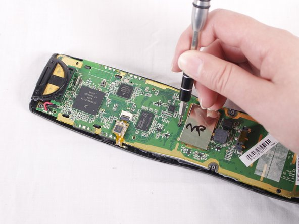Using the Philips #0 screwdriver, remove the three 50mm screws from the circuit board.
