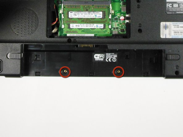 Remove the two 6.0 mm golden 'F6' screws shown underneath the battery.