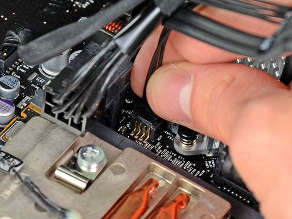 Connect the small plug on the SATA power cable to the socket labeled SSD Power on the logic board.