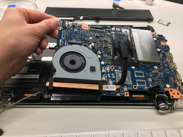 Pull up on the corner of the motherboard and remove from the laptop.