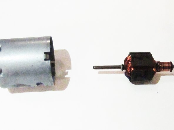 Remove the metal casing from the motor and insert the new motor in its place.