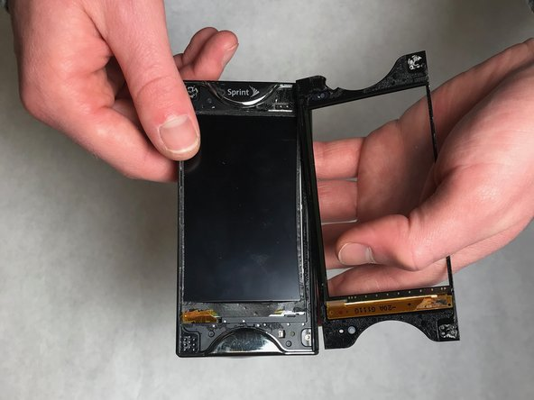 Gently wedge the metal spudger between the top screen and the phone to separate it.  Continue wedging along the outside of the screen carefully with the metal spudger until the screen is apart.