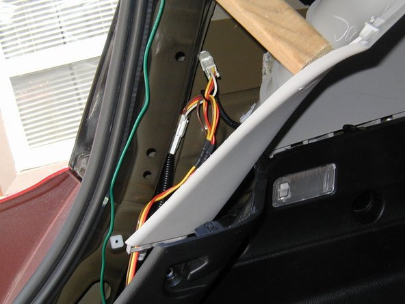 The harness on the driver's side can be separated by pressing the small tab (next step) and reconnected to the red/yellow/brown t-connector coming from the converter.