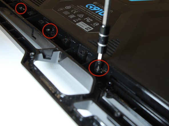 "Flip the keyboard and unscrew the ""15"" back screws."