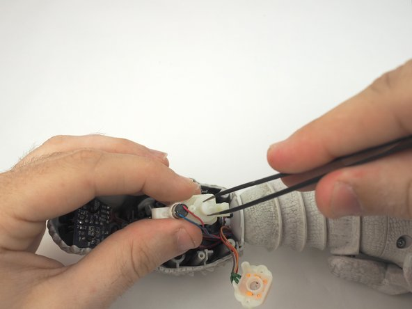 Use tweezers, inspect the main output gear for the jaw and remove if necessary.