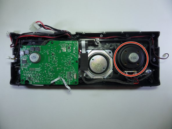 Locate the speaker adjacent to the motherboard.
