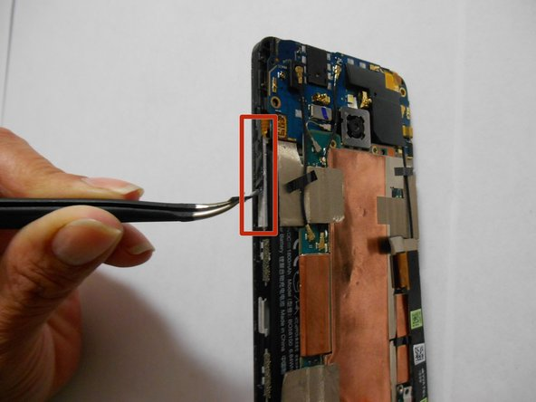 Image 1/2: Detach the power button with your tweezers. Be very careful not to tear the ribbon cable.