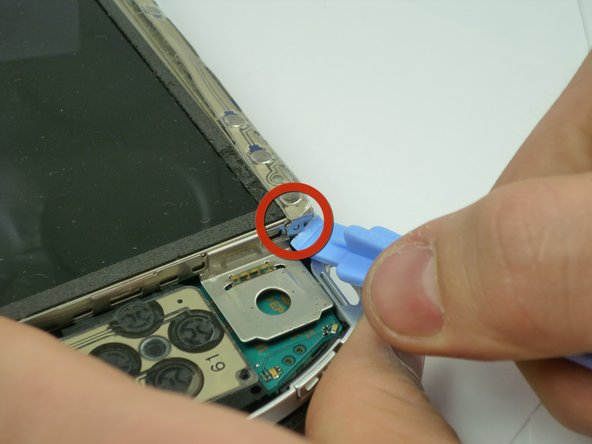 The Button Board, at the base of the  LCD Screen, is held by two clips.