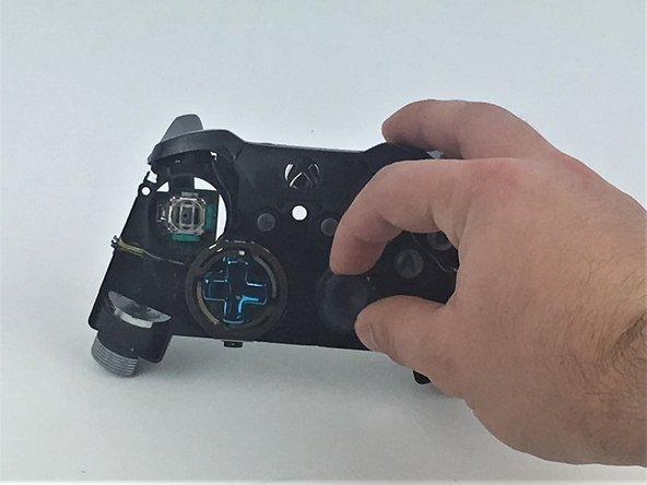Select the thumbstick that you want to replace and pull it off its pole.