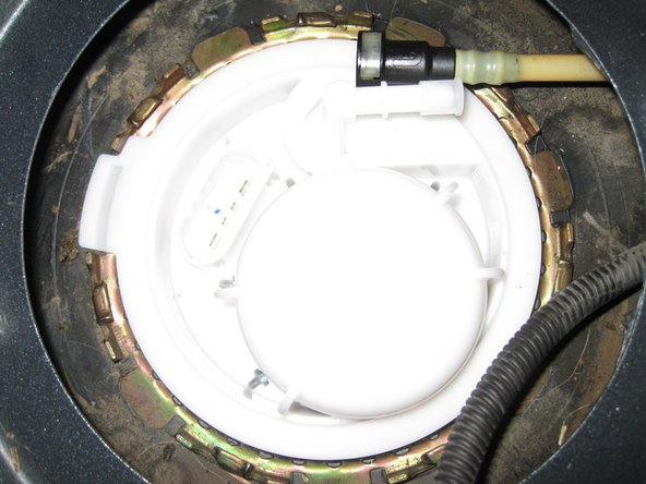 Image 2/3: The fuel filter assembly has a tab to align it with the gas tank.