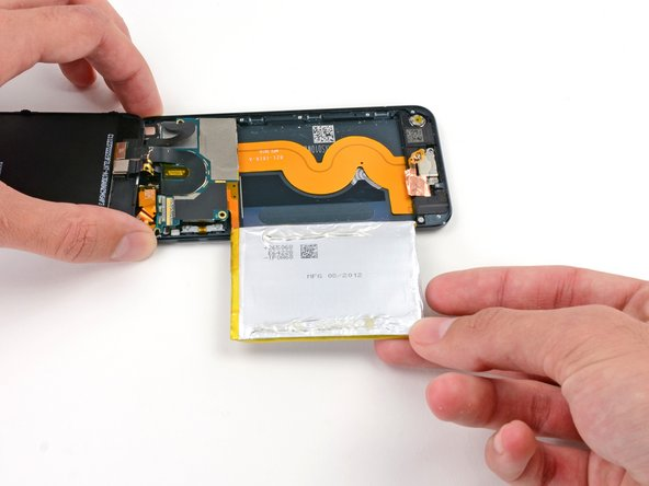 Once battery is out of case turn the battery over to straighten its cable and set it down.