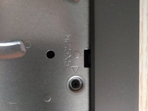 remove screw on the upper side of the laptop.