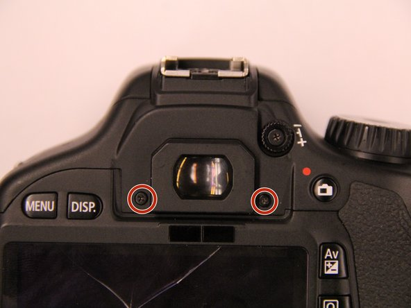 Remove the two screws beneath the eyepiece