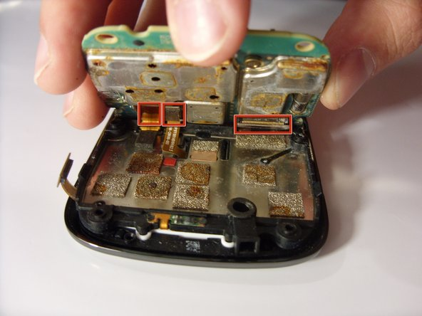 Using your fingers, carefully lift and remove the mother board.