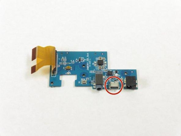 Image 1/2: Remove the Micro USB port.